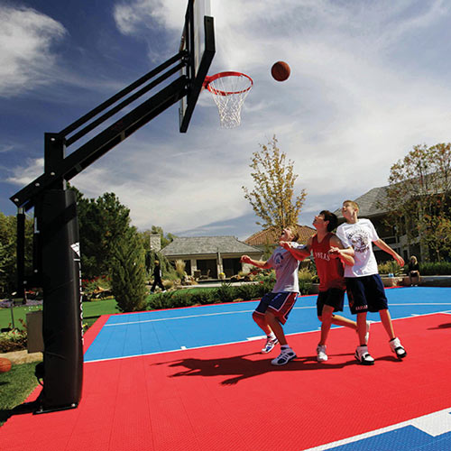 Kids playing basketball on SYNCourt outdoors