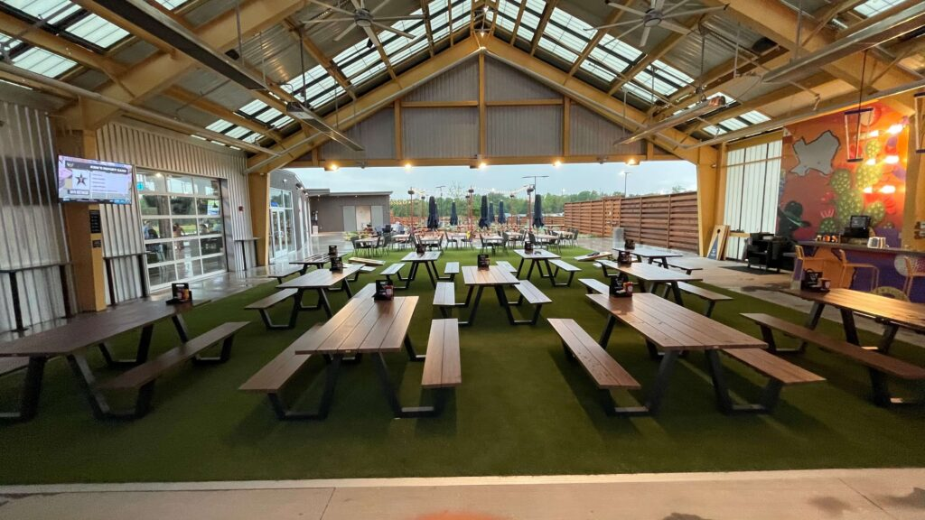 dining area with artificial turf