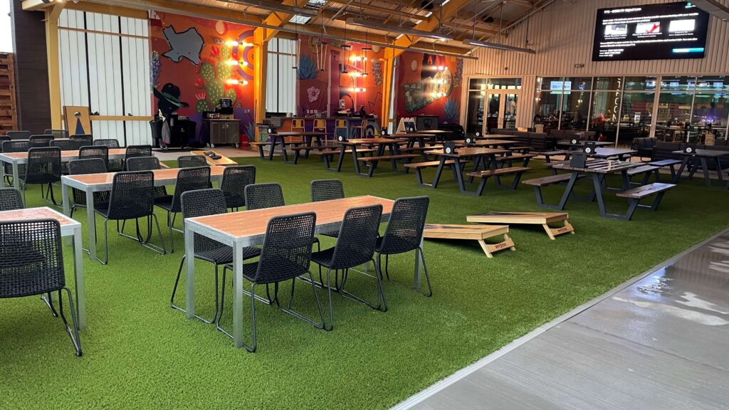 artificial turf installation in outdoor eating area
